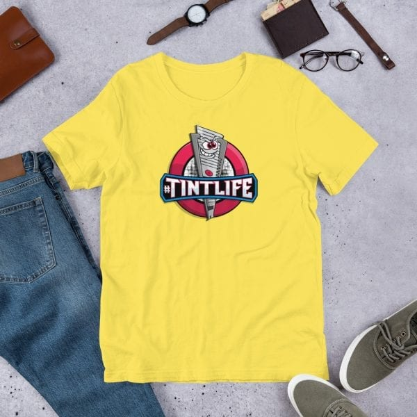 A yellow pre-shrunk, 100% combed and ring-spun cotton t-shirt with a unisex cut flattering for both men and women featuring the Red Dot - #Tintlife logo by Kari Yochum