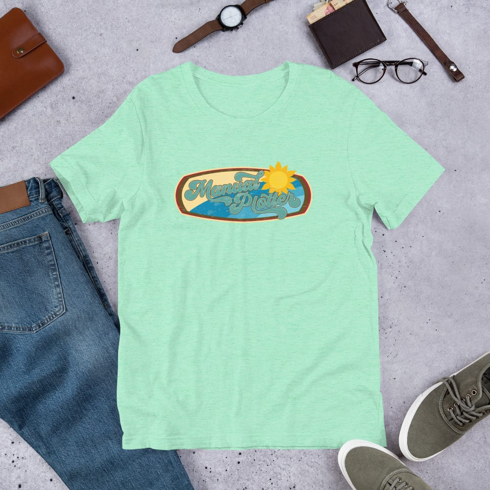 A heather mint pre-shrunk, 52% combed and ring-spun cotton and 48% polyester blend t-shirt with a unisex cut flattering for both men and women featuring the Manual Plotter - Beach Edition logo by Kari Yochum
