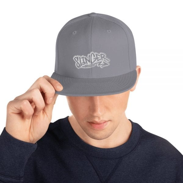 Silver Snapback style baseball cap featuring the Slinger Graffiti style logo from Kari Yochum in white embroidered lettering
