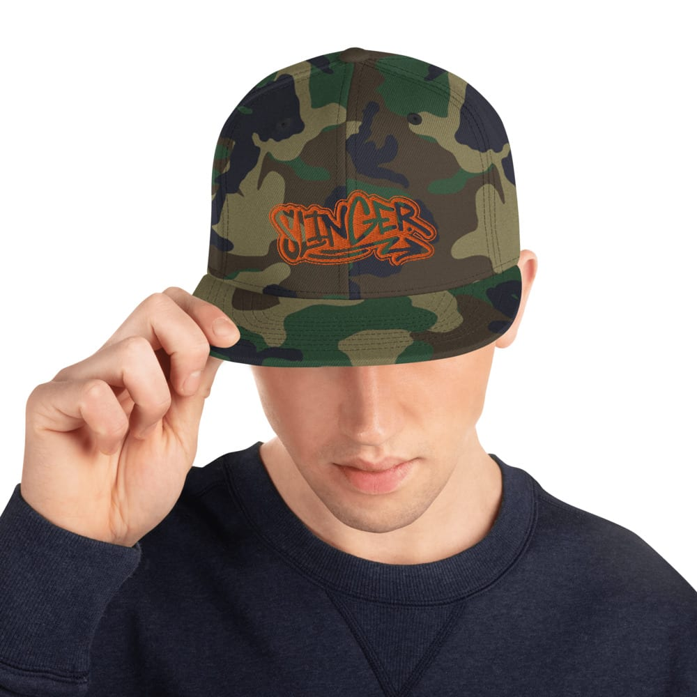 Green Camo Snapback style baseball cap with the TintLyfe Slinger stylized lettering with orange shadowing.