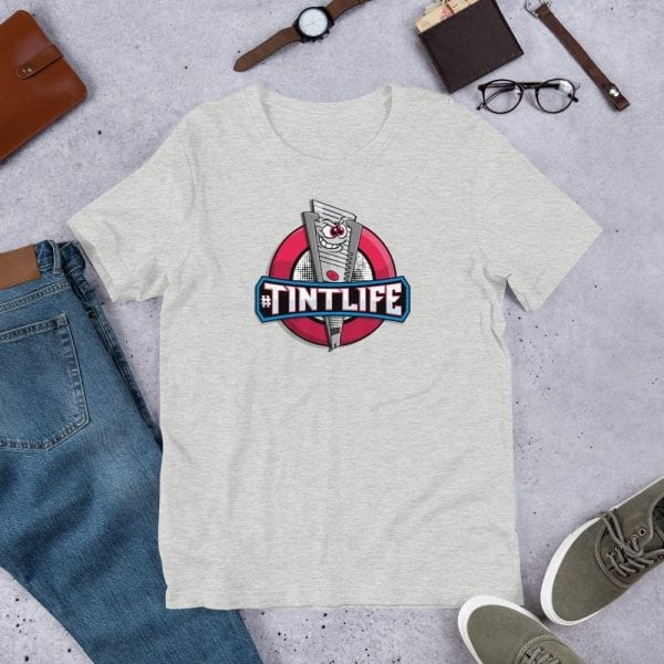 An athletic heather pre-shrunk, 52% combed and ring-spun cotton and 48% polyester blend t-shirt with a unisex cut flattering for both men and women featuring the Red Dot - #Tintlife logo by Kari Yochum