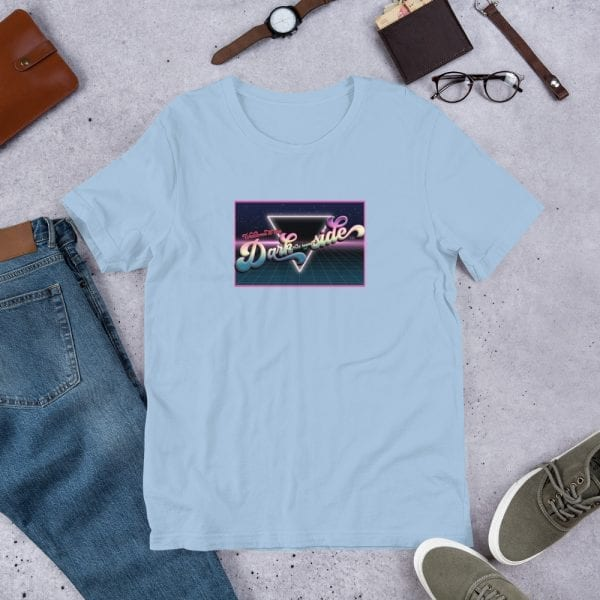 A light blue pre-shrunk, 100% combed and ring-spun cotton t-shirt with a unisex cut flattering for both men and women featuring the Welcome to the Dark (but Legal) side logo by Kari Yochum