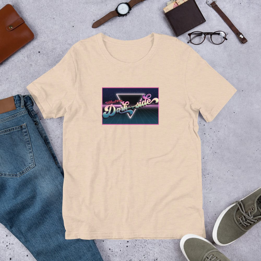 A heather dust pre-shrunk, 52% combed and ring-spun cotton and 48% polyester blend t-shirt with a unisex cut flattering for both men and women featuring the Welcome to the Dark (but Legal) side logo by Kari Yochum
