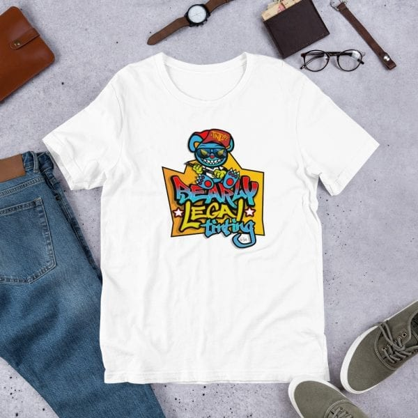 A white pre-shrunk, 100% combed and ring-spun cotton t-shirt with a unisex cut flattering for both men and women featuring the Bearly Legal Tinting - Graffiti logo by Kari Yochum