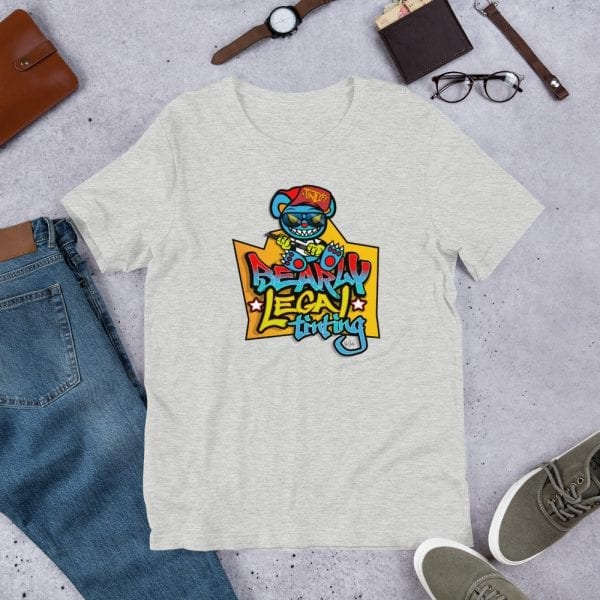 An athletic heather pre-shrunk, 52% combed and ring-spun cotton and 48% polyester blend t-shirt with a unisex cut flattering for both men and women featuring the Bearly Legal Tinting - Graffiti logo by Kari Yochum