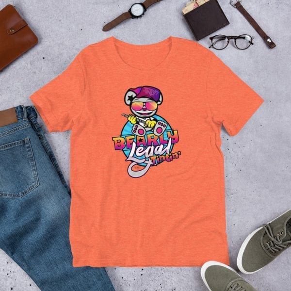 A heather orange pre-shrunk, 52% combed and ring-spun cotton and 48% polyester blend t-shirt with a unisex cut flattering for both men and women featuring the Bearly Legal Tintin' logo by Kari Yochum